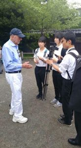 Captain Jerry Yellin speaking with Japanese students about war and peace