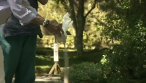 Jerry lays the ashes of his wife Helene into the river at a temple in Japan.